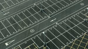 Learn about the difference between concrete and asphalt parking lots.