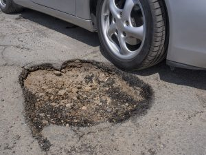 A pothole in need of asphalt patching