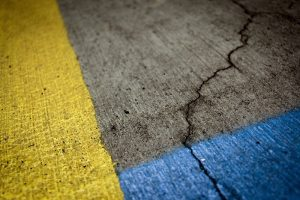 parking lot maintenance needed for cracked pavement