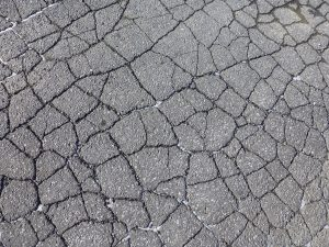 Learn what to do when the asphalt in your parking lot is wearing down.